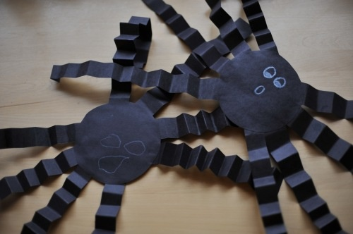 folded construction paper spiders