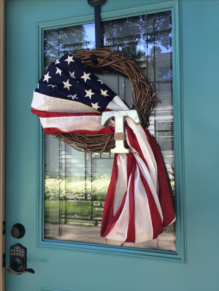 Front door decor for 4th of July. American flag wreath with initial.