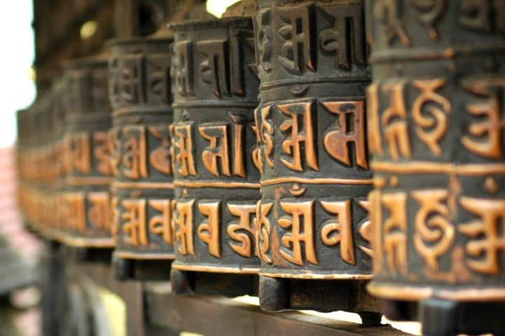 Prayer wheels, Kathmandu.  Walking around the temple spinning the wheels is definitely on my list of things to do.