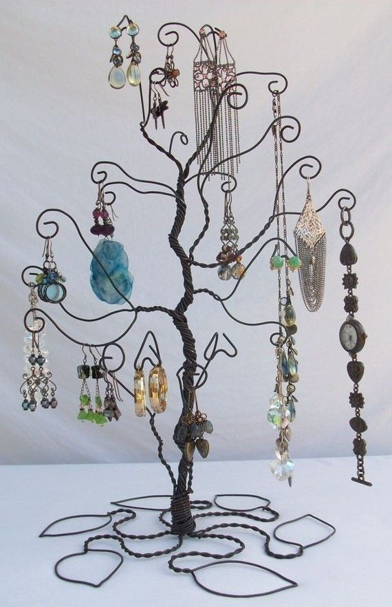 Jewelry tree. Wind wire around a clean branch and curl the ends about. Just beautiful! Could even spray paint for an even color.
