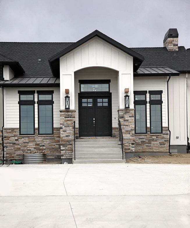 Modern rustic white farmhouse Black doors Black trim