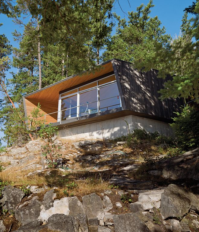 Dwell  |  Perched over a cliff face, the hooded deck of the Gambier Residence reads like a ship's prow over Howe Sound, the scenic waters near Vancouver.