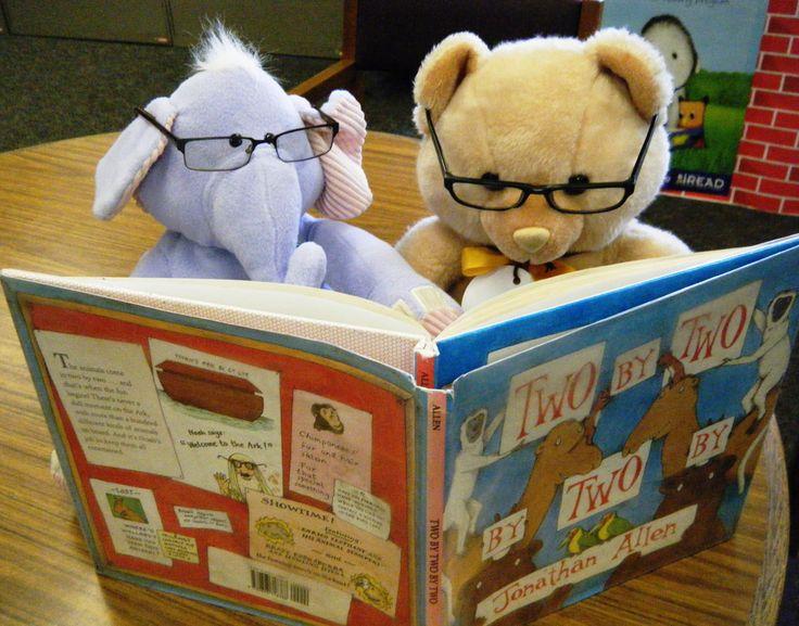 Photo of stuffed animals reading.