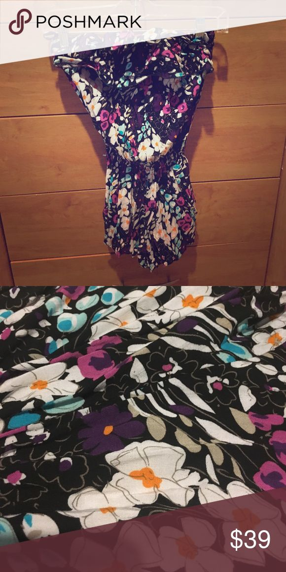 Strapless floral romper. Beautiful floral print on black. Ruffles on the chest so it's easy to wear without a bra. Elastic band at the top and the waist make it a really flattering fit. Perfect for the summer days! ☀️ bought at a boutique. Pants Jumpsuits & Rompers