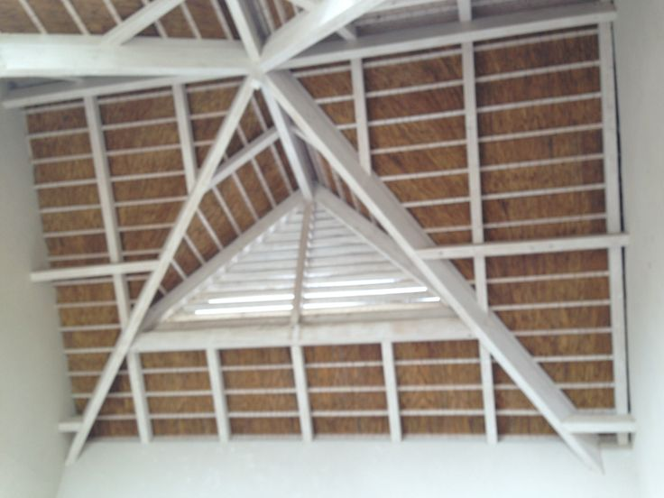 Thatch roof with spruce trusses with a lime washed finish.
