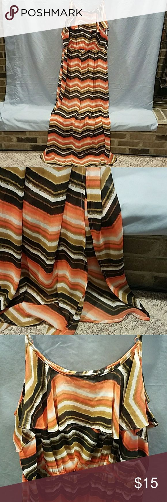 Woman's 3X Chevron Maxi Dress Woman's 3X Chevron Maxi Dress. Slit on the left bottom only goes up 21 inches from the bottom. Black, orange tones, browns, and white. Spaghetti straps, ruffle goes around the top and it has an elastic waist. It's made from 100% polyester and it measures 57 inches from top to bottom. HeartSoulPlus Dresses Maxi