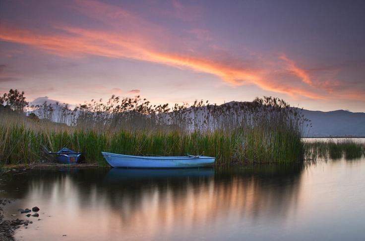 Sunrise in small lake Prespa, National Park Prespes, Florina , Greece.