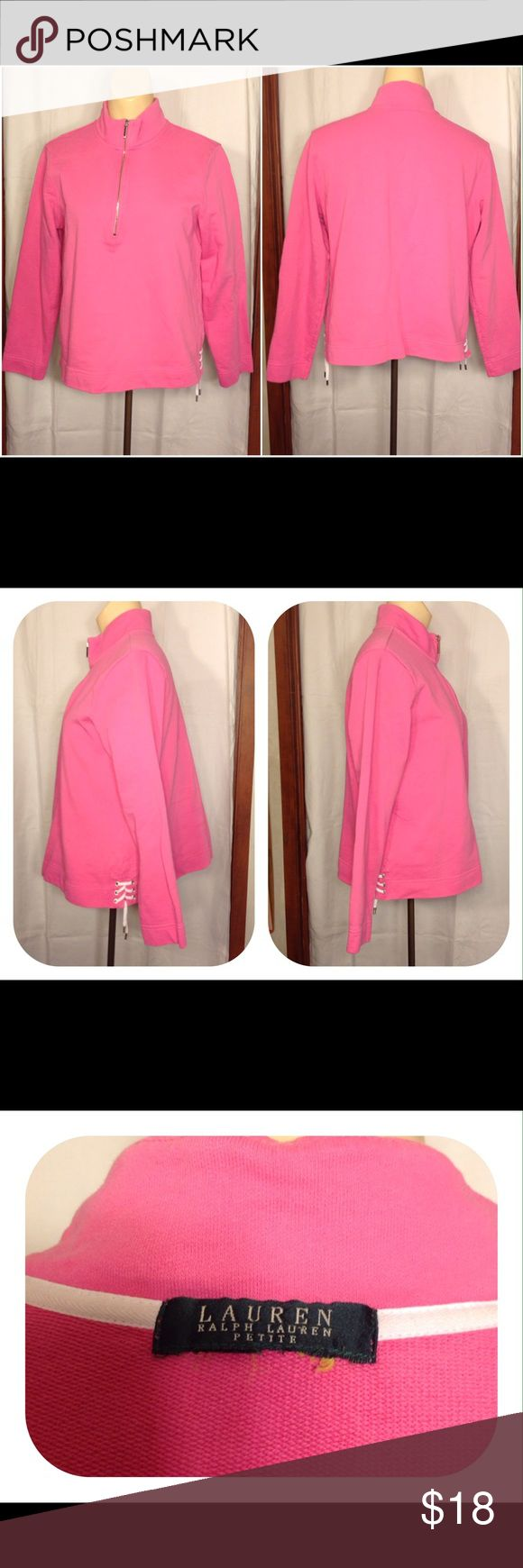 Pink Ralph Lauren Petite Pullover Sweatshirt Women's pink Ralph Lauren Petite pullover sweatshirt.  This beautiful pullover sweatshirt is a partial zip up shoestring tie on each side near hemline and no exterior pockets.    Measurements   Armpit = 20.25   Shoulder = 16   Sleeve = 21   Length = 22.25  1#46 Ralph Lauren  Petite Other