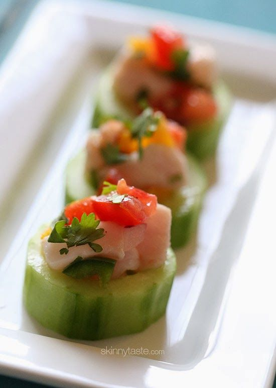 """Ceviche in Cucumber Cups by skinnytaste: This poplar Peruvian fish dish is """"cooked"""" in lime juice along with onions and cilantro – the results are fresh and vibrant. #Appetizers #Ceviche #Cucumber #Light #Healthy"""