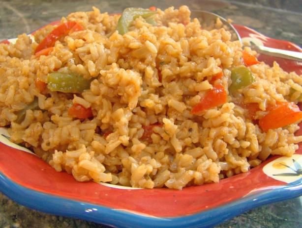 Cajun Rice from Food.com:   								This is another recipe I got from one of our potlucks at work.  My husband likes this one.  It is a little warm, so better test it before giving it to the kids.