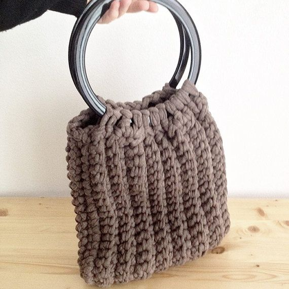 #Shoulder #bag with two handles and drives round blacks with brown elastic webbing. This bag was made with the plot at hand, so without the use of tools to do the knitting or crocheting.  To have this bag in another color please email me a message!