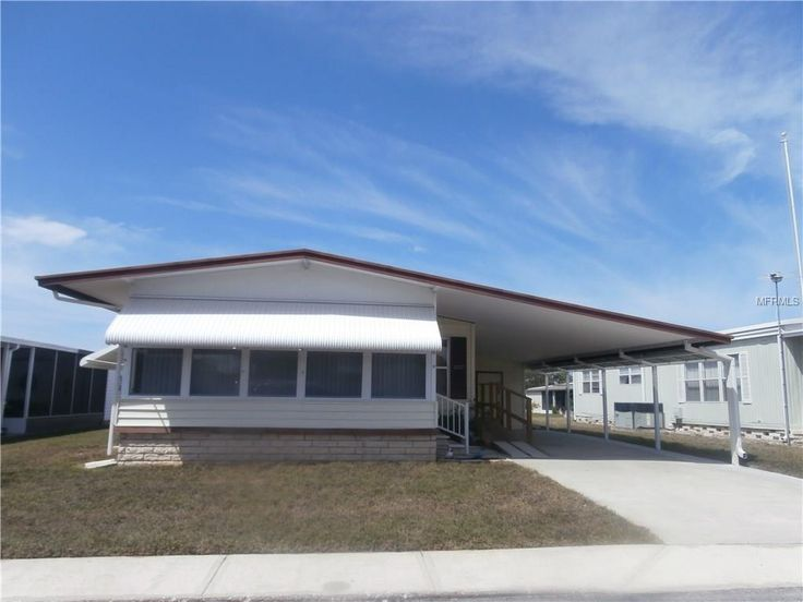 3227 HAMPSHIRE DRIVE, Holiday, FL 34690 $54,900 - Need a completely furnished 2 bedroom, 2 bathroom, double wide mobile home in s very active 55+ community with low monthly fee. Then look no further. Features furnish air conditioning Florida room, laminated flooring , loads of storage, space workshop area in the double storage shed. Heated sq ft includes Florida Room — My Florida Regional MLS #: W7628569