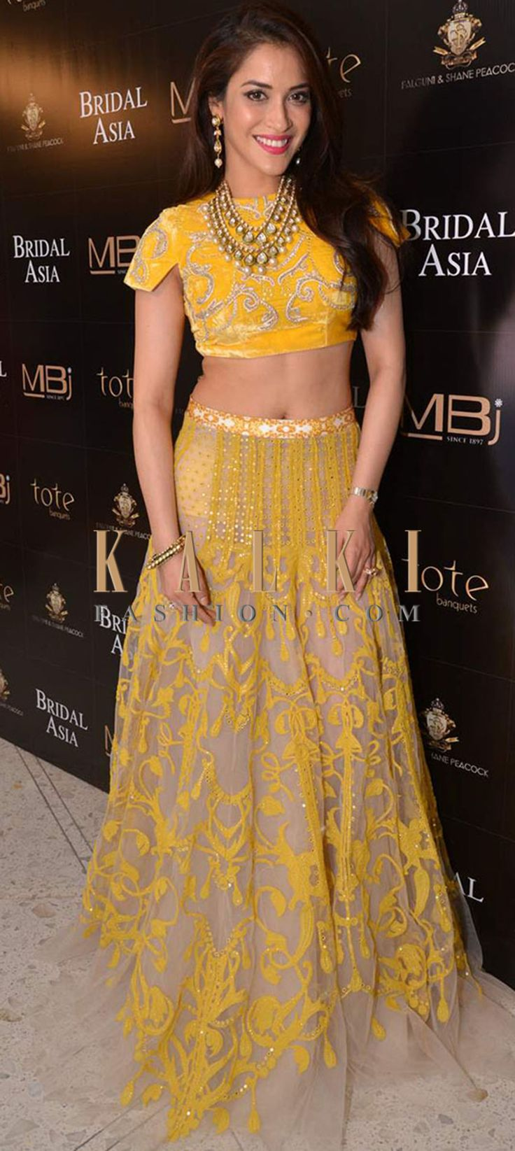 Pretty yellow and gold lehenga. Find a style match to the celebrity look of your choice @http://www.kalkifashion.com/lehengas.html
