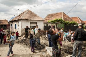Romani residents of Cheriu, Romania fill the streets as one family gets running water installed into their home on May 14, 2013. The family was able to maintain running water for only a few weeks before they were unable to pay the bill and it was shut off.Story and photos by photojournalist Daniel Owen, .