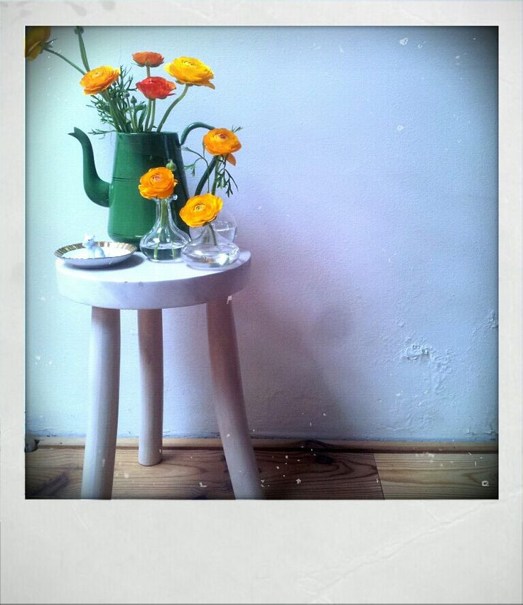 Flowers on white stool