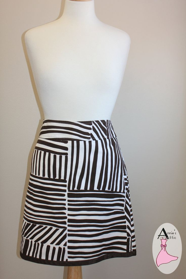 Ann Taylor summer skirt, animal print, size 10 Brown and white print, zips up left side Lined $19