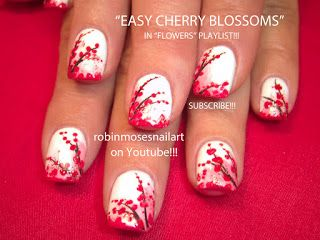 I adore this cherry blossoms nail art