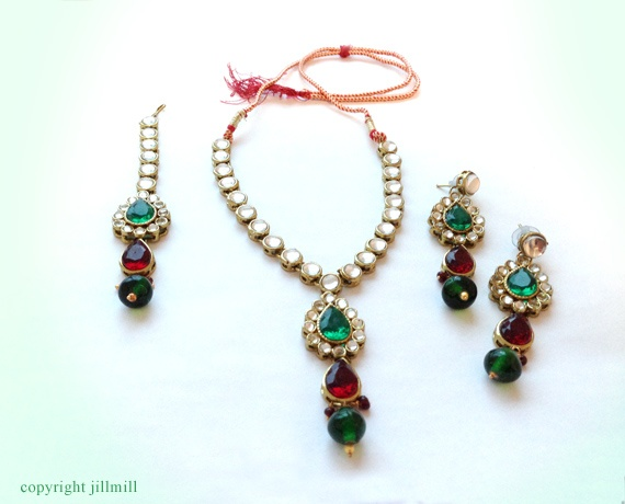A perfect wear for any Indian occasion, this set has a classic combination of white, green and maroon.