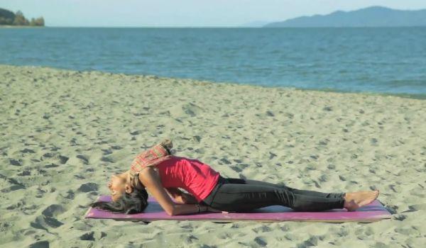 Zain Saraswati Jamal demonstrates a yoga pose that helps fight backache, fatigue, anxiety, and even menstrual pain.