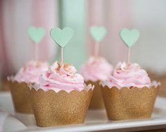 pink strawberry cupcakes | gold cupcake wrappers