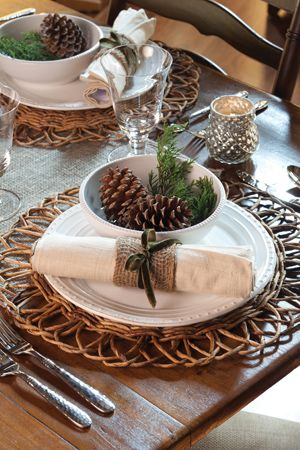 Rustic setting with twigs, fresh greens and pinecones pared with white chine, silver and crystal.