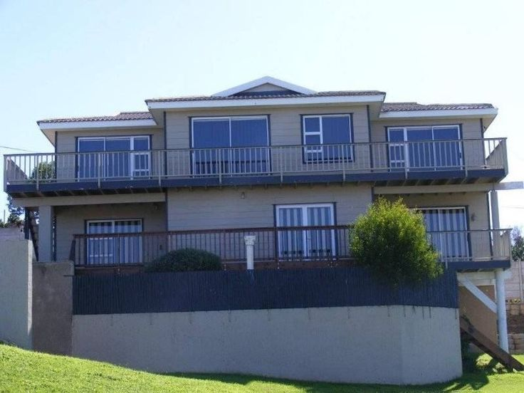 Plankies - Nestled down a quiet lane in the conservation village of Dana Bay, this double storey house accommodates a total of ten guests comfortably, and is within a short walk of the beach.  Three double bedrooms ... #weekendgetaways #danabay #southafrica