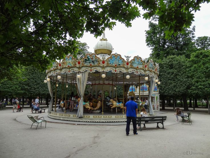 Found within the Tuileries Gardens this is a traditional Merry-go-round with ornate designs all around.  Daily updates at www.eutouring.com/images_tuileries_garden_48.html