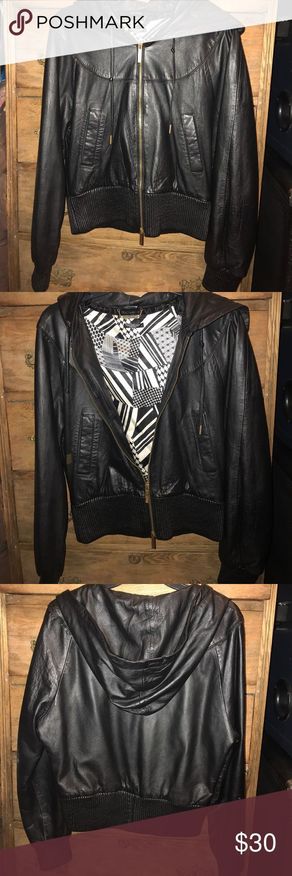 Leather bomber jacket Black leather bomber jacket. Has two pockets and a black leather hood (not detachable). Tighter fit around waist, looser fit on arms, back, and front. Bronze zipper and metal detail. Lining on the inside, perfect for cold days! Ecko Unlimited Jackets & Coats Puffers