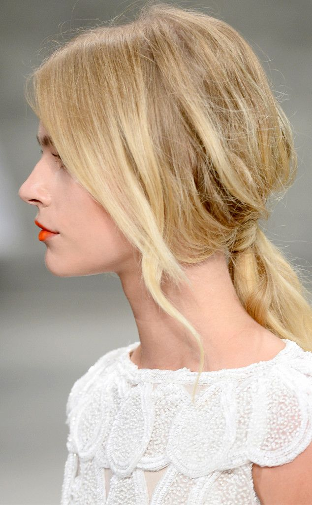 There we're a lot of polished ponytails on the Spring 2015 runways, but almost prefer this undone style.