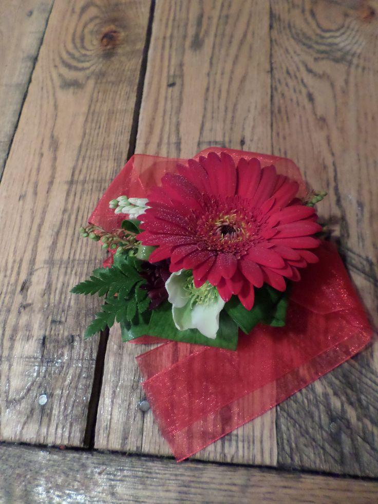 Mini red gerbera wrist corsage. Designed by Florist ilene, Hamilton, NZ