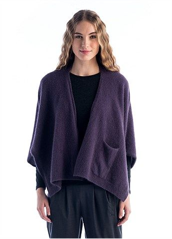Th sculptural Queen Bee Wrapis made from our cosy and luxurious Ecopossum, fine Merino, possum and silk blend. Designed to be multi-tasking it can be worn 2 ways to create a cropped or longline look. Warm and delightful, with a pocket for practicably this will be your most versatile staple this winter.  Model is …