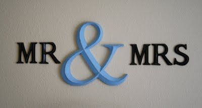 Above the bed; spray painted hobby lobby letters