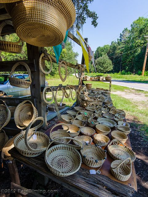 Sweetgrass basket weaving was brought to the Charleston, South Carolina region by slaves who were brought from West Africa.  The art form has been passed from generation to generation.  You can watch artisans at work and purchase baskets at the Charleston City Market.  You can also drive along the Lowcountry roads and find roadside stands such as this one in Edisto Island, South Carolina.