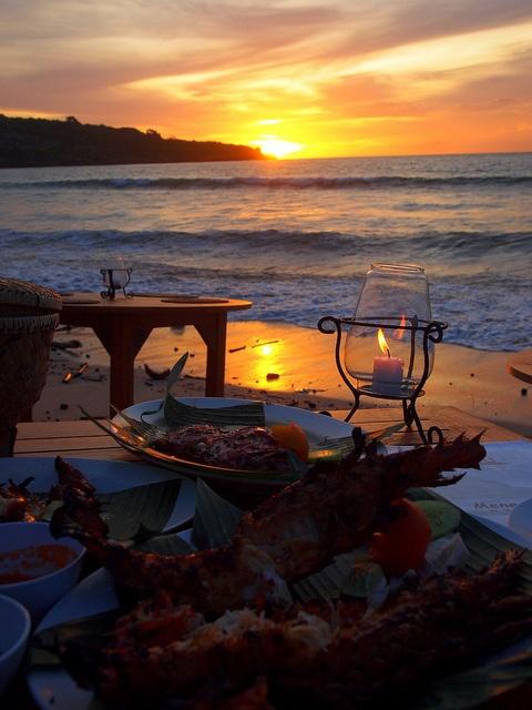 Jimbaran Bay, BALI.   Ocean side seafood dining during sunset.