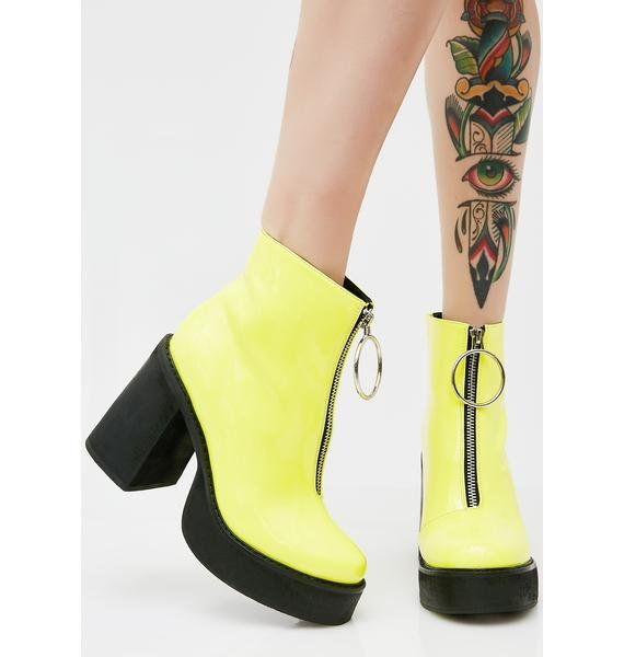 4256f068f408 Current Mood Neon Franky Platform Boots got ya feelin  sweet N  sour. These bright  yellow boots have black platform soles