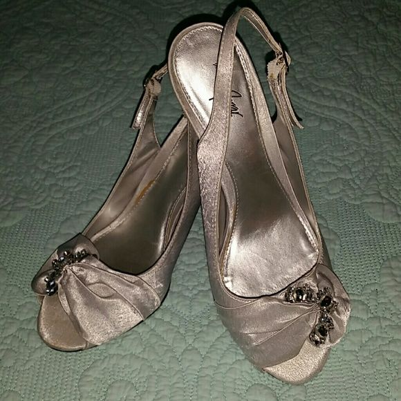 Silver Peep Toe heels Ultra feminine and very comfortable these peep toe heels are perfect to complete your wedding emsemble if you are gping to be a Mother of the Bride or Mother of the Groom !  (I wore these at my son's wedding and danced the night away at the reception)!  Still in like new condition and still in original box. Jacgueline Ferrar Shoes Heels
