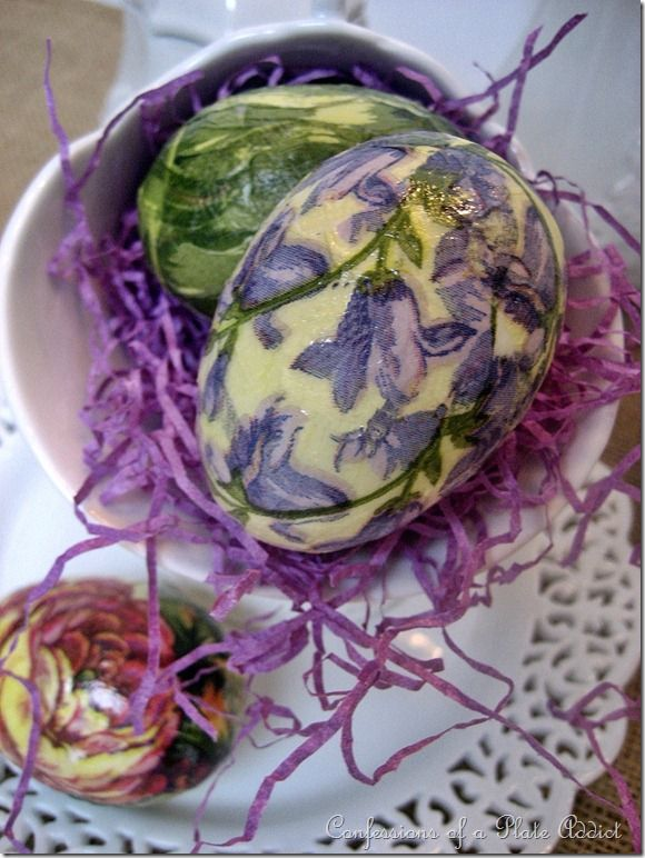 These plastic eggs were made by adding small cut-outs one at a time...little purple flowers for one, and leaves from the tulips for the other. Spray paint the eggs ivory first.
