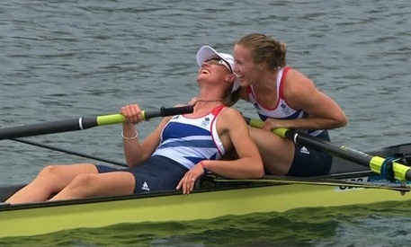 319b - This picture encapsulates a sense of relief felt by the athletes after a heavy burden of pressure to win Team GB's first gold medal. One of the athletes is shown comforting her team mate, suggesting compassion, friendship and teamwork. The audience are able to personalize with the athletes' faces, as the shot is a close-up. The audience are able to connect with their country's new sporting heroes. The river looks calm, suggesting there is a now peaceful mood and a sense of…