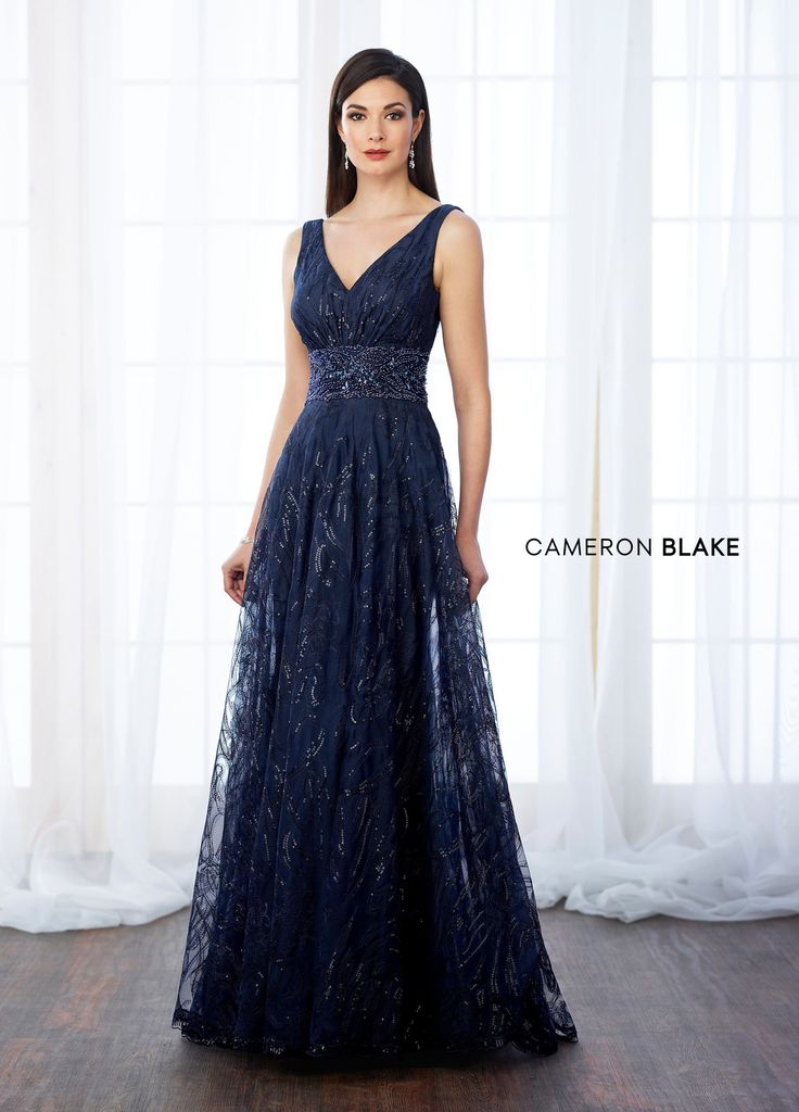 Cameron Blake 217645 - Sleeveless sequin and tulle A-line gown with front and back V-necklines, hand-beaded wide natural waistband, sweep train. Matching shawl included.