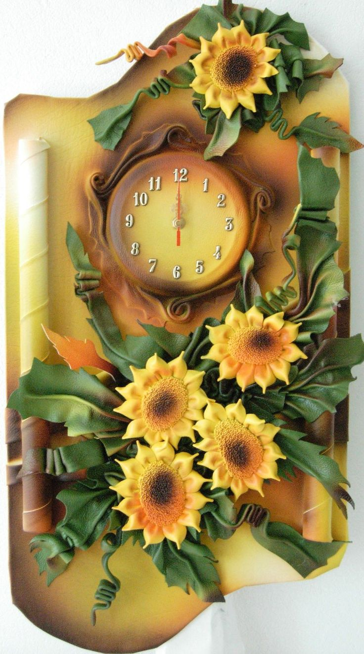 Unique 3D Leather Art Sunflowers with Clock  Size: 38cm x 70cm  Color: Light and Dark Brown,Cream,Yellow,Burgundy,Green,Orange  Material: Genuine Leather,  Wood Clock requires one R6 –AA battery to operate (not included)  Using silent motor  Ships well protected