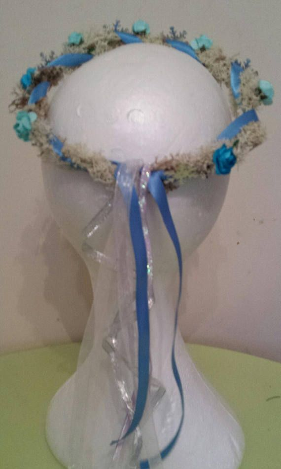Childrens Frozen crown, a very sweet costume accessory or photo prop. It is made from real preserved white and natural reindeer moss. Little faux roses, and sparkly snowflakes. And blue, white and silver ribbons. The one pictured will fit age from age 2 up to age 3/4. But I can