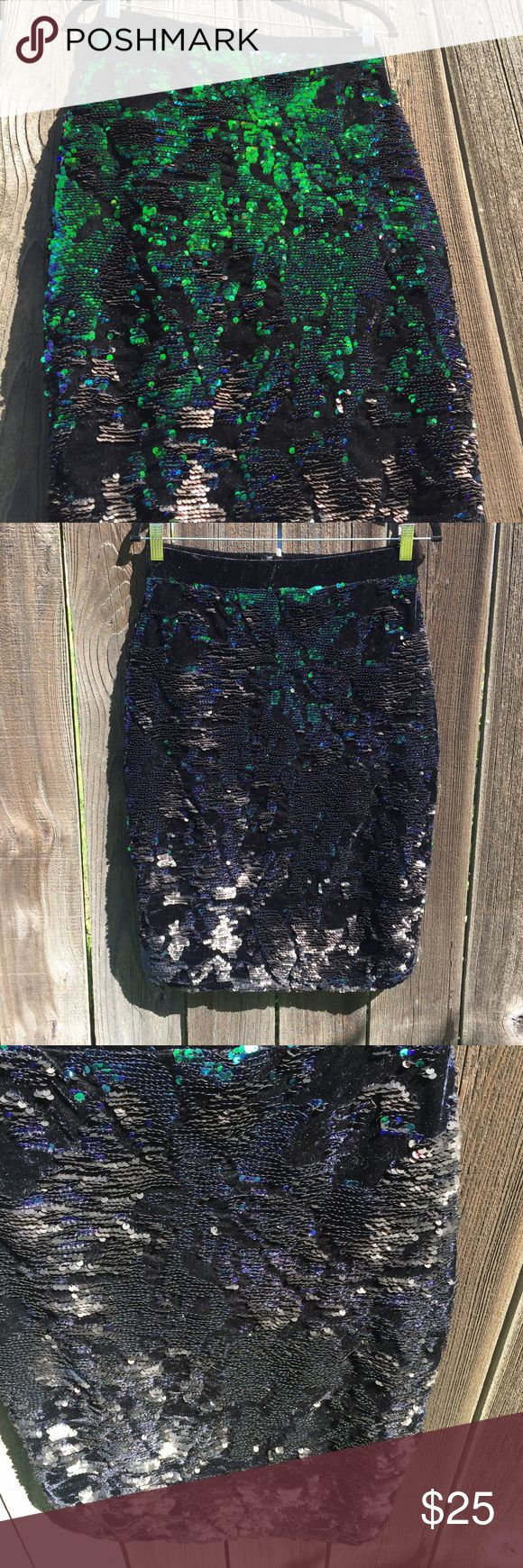 Topshop Velvet Sequin skirt This skirt by Topshop is very unique! It fit me in the waist but I didn't have the hips to wear it. It is all black velvet with two tone sequins on it. You can flip the sequins one way for a blue/green turquoise color or lay it down for a matte black. (I tried to show this in the pics) It is a thick skirt & has an exposed zipper on the back. For length, it should sit on the knee.  If it doesn't fit, you can probably still return it at Nordstrom, for store credit…