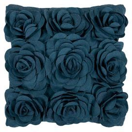 "Wool pillow in marine blue with rosette appliques and a polyester fill.   Product: PillowConstruction Material: Wool cover and polyester fillColor: Marine blueFeatures: Insert includedDimensions: 20"" x 20"""