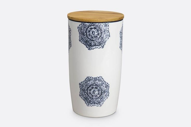 "Large canister with wooden top. Measures 9""H x 5""D. Stoneware with white glaze and dark blue lace pattern. Stoneware is microwave and dishwasher safe. Wooden top can be hand washed with warm water, mild soap and a soft sponge.  Towel dry the wooden top. Don't submerge the wooden top in water.  SKU# VB56018"
