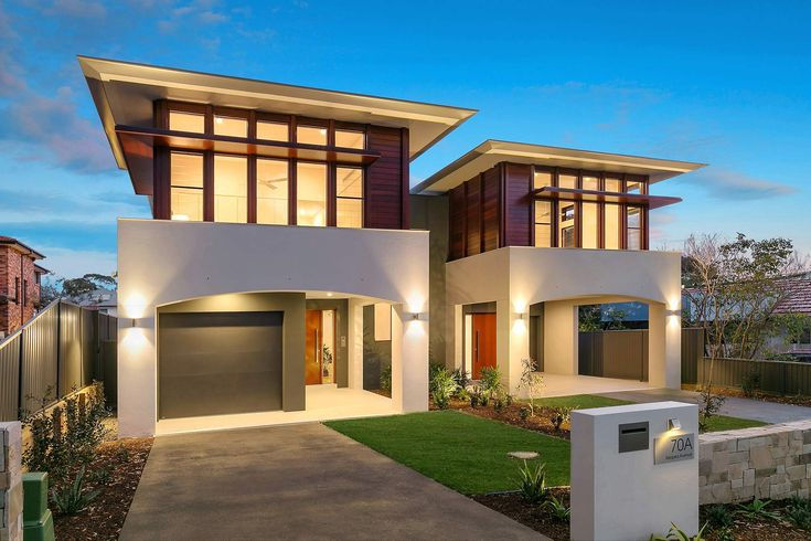 Contemporary Dual Occupancy Sydney | pavilion design | Modern home | architecture | Timber facade | cedar cladding | arches | timber hood | oriental inspired | open plan | ceaserstone kitchen | modern kitchen | courtyard | loungerrom | side by side | modern townhouse | exterior facade | highlight windows | timber floors |