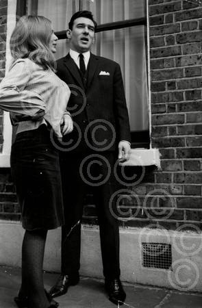 Reggie Kray and Frances Shea outside the Kray home in Valance Road after he and Ronnie are aquitted of all charges of demanding money with menaces, 5th April 1965.