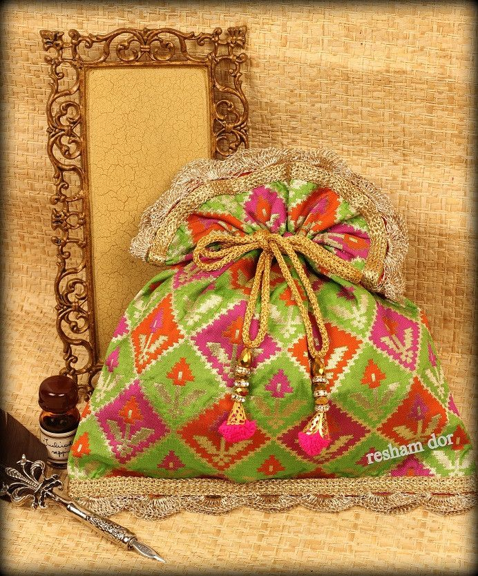 RD 1064 Manjari- Stunning potli in tricolor banarasi brocade with zari- a very dressy one! Price: Rs.2490