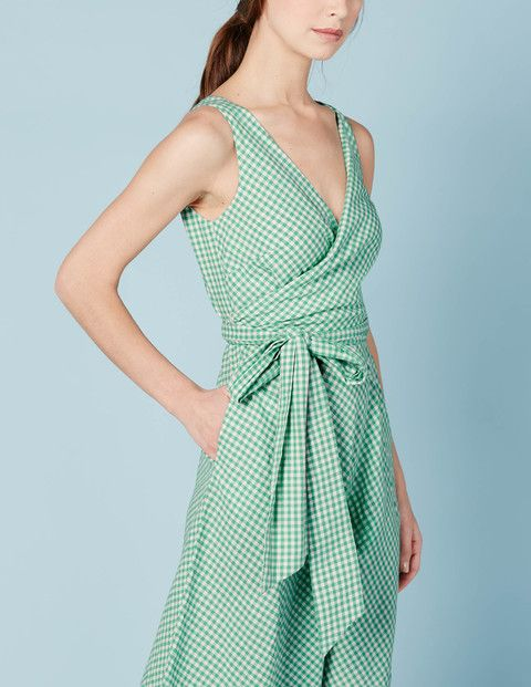 Bring a bit of Fifties glamour to the Riviera of your choice (or just the neighbours' garden BBQ) with this flattering, wrap dress. Crafted from soft cotton linen, this dress is all about the shape: the structured waist nips you in, while the cut-on-the-biasflippy skirt adds an extra feminine touch.