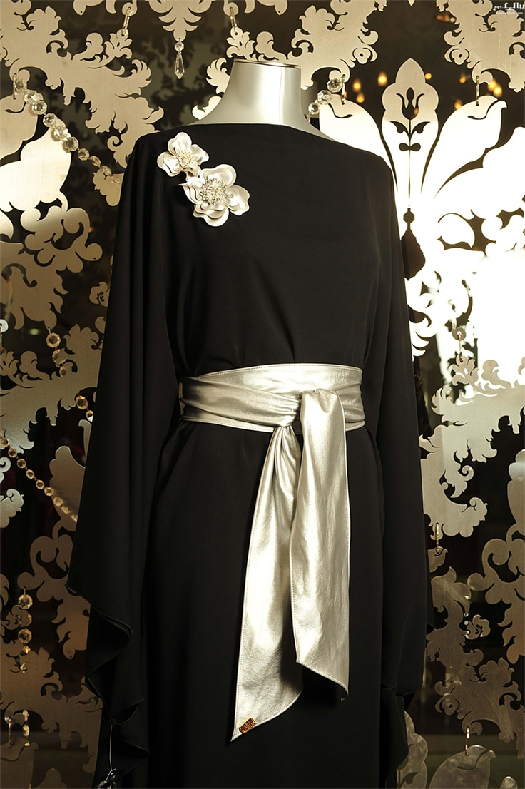 This DIY gown is ideal for someone who doesn't want to spend a lot of money on a new dress for an event.  All you need is a black abaya or long-sleeved dress.  Purchase a yard of gold metallic fabric and tie it around waist.  Two gold broaches near the shoulder area offers a fabulous finishing touch while keeping your khimar in place. - Habiba West