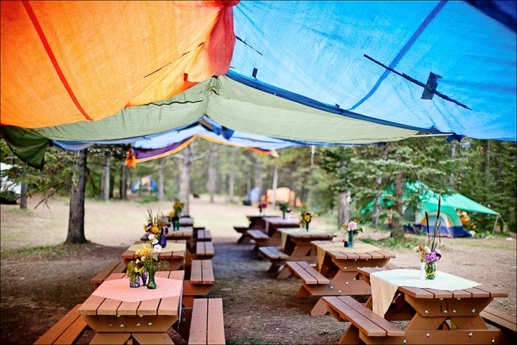 Make a big tent for shade out of several tarps if this is cheaper than renting tents
